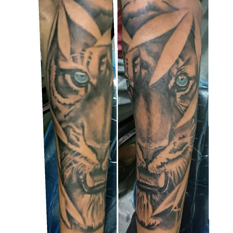 Zion and Dark Horse Tattoo and Piercing Studio – Yuh Belly Biting